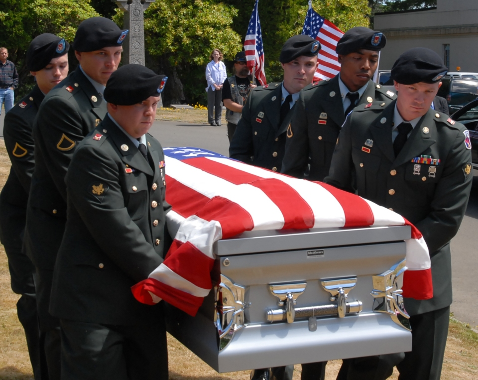 PFC Aaron E Fairbairn carried to his final resting place flag casket